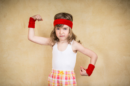 feminism: Funny strong child. Girl power and feminism concept Stock Photo