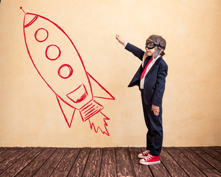 Portrait of young businessman with drawn rocket. Success, creative and startup concept. Copy space for your text
