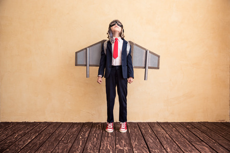 Portrait of young businessman with toy paper wings. Success, creative and startup concept. Copy space for your text 스톡 콘텐츠