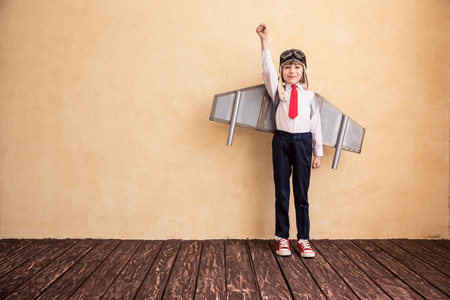 happy businessman: Portrait of young businessman with toy paper wings. Success, creative and startup concept. Copy space for your text Stock Photo