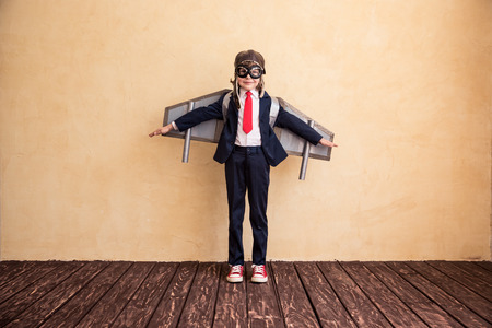 Portrait of young businessman with toy paper wings. Success, creative and startup concept. Copy space for your text 免版税图像