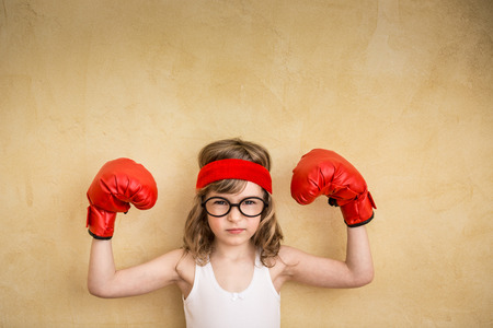 super human: Funny strong child. Girl power and feminism concept Stock Photo