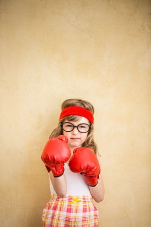 powers: Funny strong child. Girl power and feminism concept Stock Photo