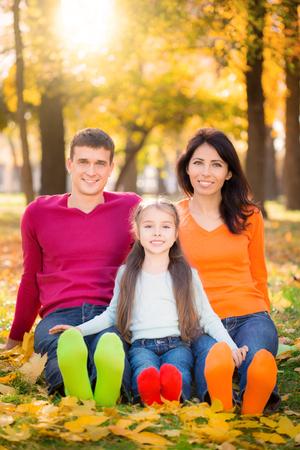 family portrait: Happy family having fun outdoors in autumn park