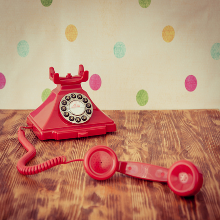 ancient telephone: Retro phone on wood table