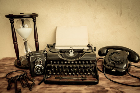 ancient telephone: Retro typewriter with paper blank on wood table. Top view Stock Photo