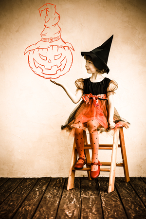 flying witch: Funny child dressed witch costume. Halloween holidays concept