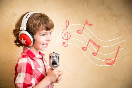 dj boy: Kid listen music at home. Hipster child with retro vintage microphone