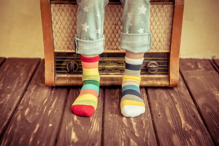 Kid listen music at home. Hipster child with retro vintage radio 스톡 콘텐츠