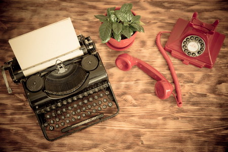 ancient telephone: Retro phone and typewriter. Top view Stock Photo