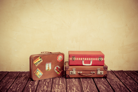 Vintage classic brown leather suitcase. Travel concept