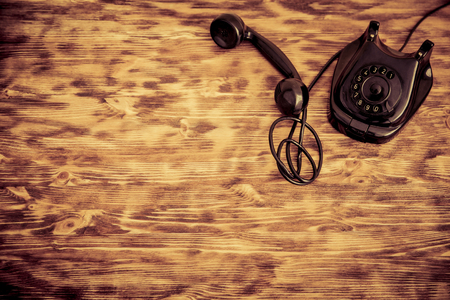 retro phone: Retro phone on wooden background. Top view Stock Photo