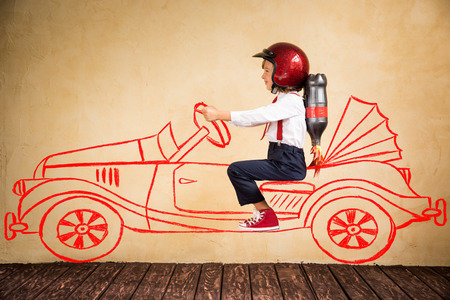 Portrait of young businessman with jet pack riding drawing retro car. Success, creative and innovation technology concept. Copy space for your text