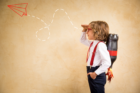 Portrait of young businessman with jet pack in office. Success, creative and innovation technology concept. Copy space for your text Archivio Fotografico