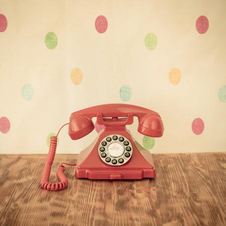 retro phone: Retro phone on wood table