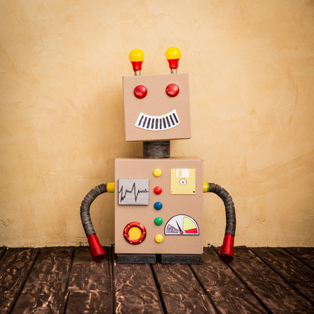 successful student: Funny toy robot. Innovation technology and creative concept