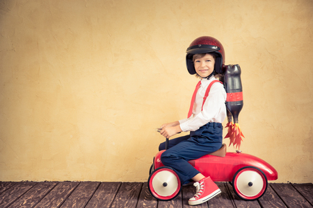 Portrait of young businessman with jet pack riding retro car. Success, creative and innovation technology concept. Copy space for your text Stock Photo