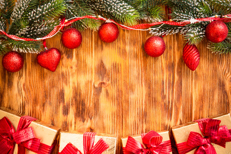 christmas tree branch: Christmas tree branch with decorations on wood background. Xmas holiday concept Stock Photo