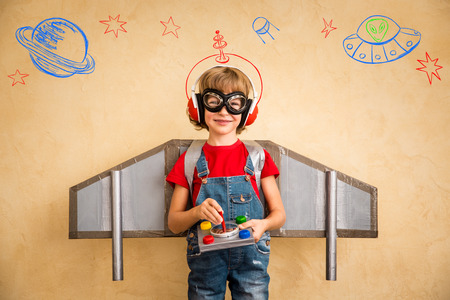 geek: Kid pilot playing with toy jetpack at home. Success and leader concept Stock Photo