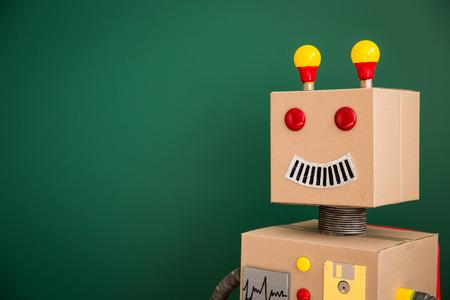 Toy robot against blackboard in class
