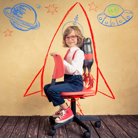 Portrait of young businessman with jet pack riding office chair. Success, creative and innovation technology concept. Copy space for your text Archivio Fotografico