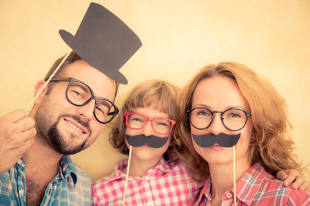 making fun: Family with fake mustache