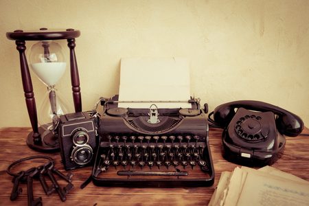 communication occupation: Retro typewriter with paper blank on wood table. Top view Stock Photo