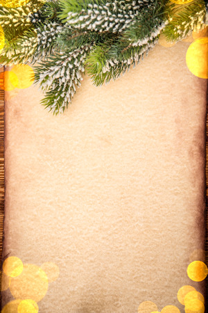 christmas lights background: Christmas tree ornament on vintage paper card blank. Xmas holiday concept Stock Photo