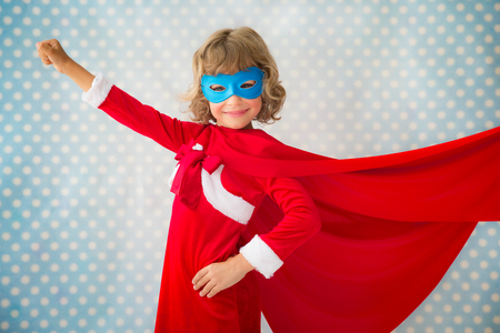 super red: Superhero kid at home. Christmas holiday concept Stock Photo