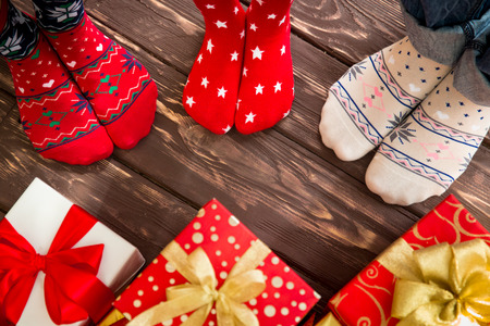 holiday: Feet of family on wood floor. Christmas holidays concept