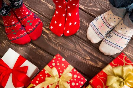 feet: Feet of family on wood floor. Christmas holidays concept