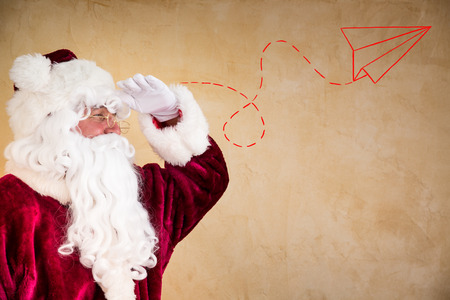looking ahead: Santa Claus looking ahead. Christmas holiday concept Stock Photo