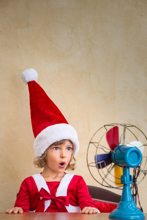 surprised kid: Surprised kid and powerful ait fan. Funny Christmas concept