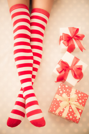 legs stockings: Sexy Santa woman legs. Christmas holiday concept. Top view Stock Photo