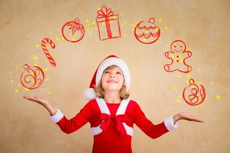 juggling: Child juggling drawn Christmas decoration. Xmas holiday concept