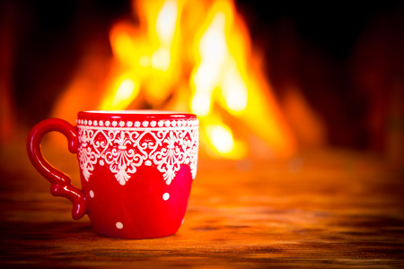 fireplace: Christmas ornament near fireplace. Winter holiday concept