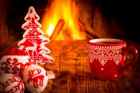 winter holiday: Christmas ornament near fireplace. Winter holiday concept