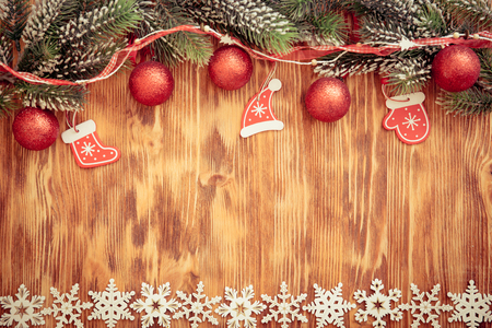 xmas background: Christmas tree branch with decorations on wood background. Xmas holiday concept Stock Photo