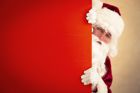 holiday home: Santa Claus holding banner blank. Christmas holiday concept Stock Photo