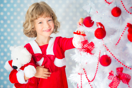 miracle tree: Child playing at home. Christmas tree. Xmas holiday concept