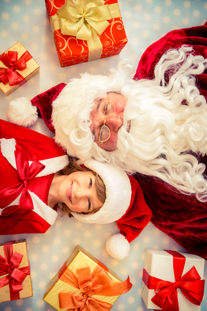 top clothing: Santa Claus and child. Christmas gift. Xmas holiday concept. Top view