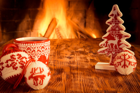 hearth and home: Christmas ornament near fireplace. Winter holiday concept