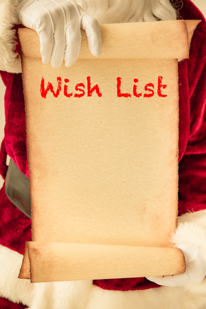 scroll: Santa Claus holding scroll paper blank in hands. Christmas holiday concept