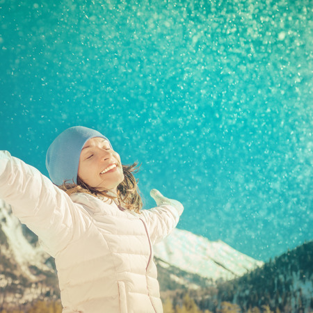 open hands: Freedom concept winter holiday vacation mountain woman