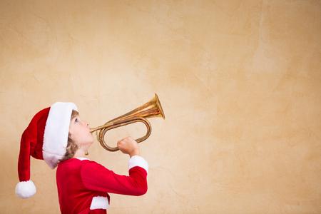 Funny Santa kid with drawn megaphone. Christmas holiday concept Archivio Fotografico