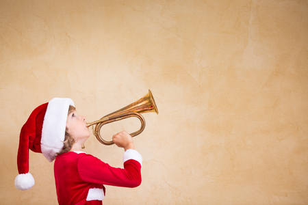 announcement message: Funny Santa kid with drawn megaphone. Christmas holiday concept Stock Photo