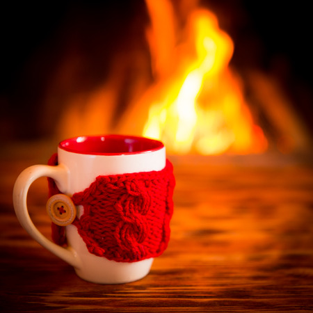 snug: Christmas ornament near fireplace. Winter holiday concept