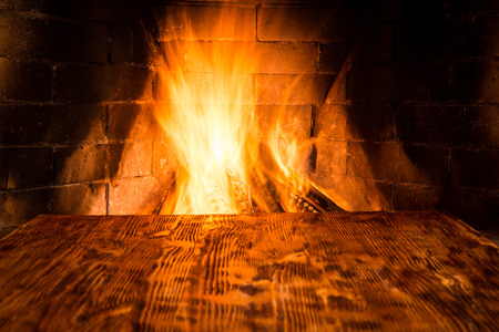 hearth and home: Wood background against fireplace. Winter holiday concept