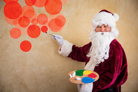 painter and decorator: Santa Claus painter. Christmas holiday concept