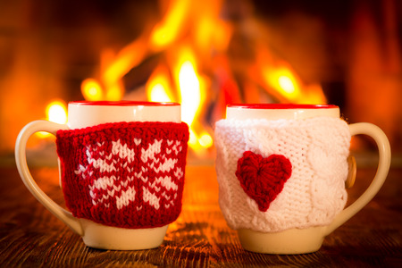 hot beverage: Christmas ornament near fireplace. Winter holiday concept